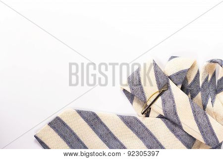 Striped tie with tie clip isolated on white background