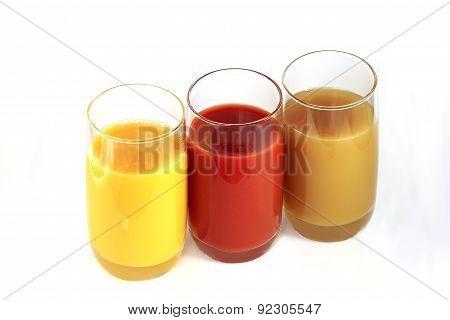 Three Glasses With Orange, Tomato And Apple Juice