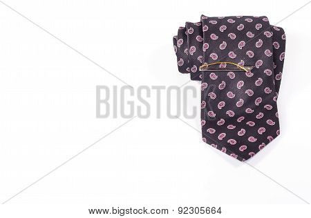 tie roll with tie clip isolated on white