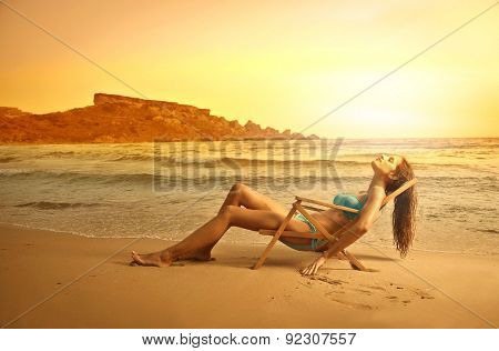 Relaxed girl at the beach
