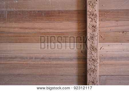 Teak Wood With Dust After Drilling