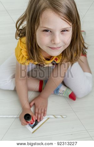 Little Girl Working On Diy Project