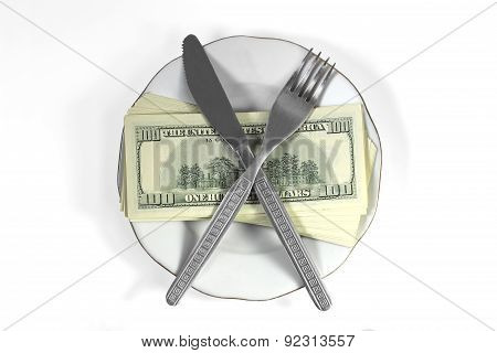 A Stack Of Dollar Bills, Knife And Fork Lying On A Silver Platter With A Golden Platter