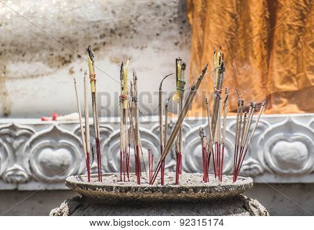 joss stick solute for Buddha statue