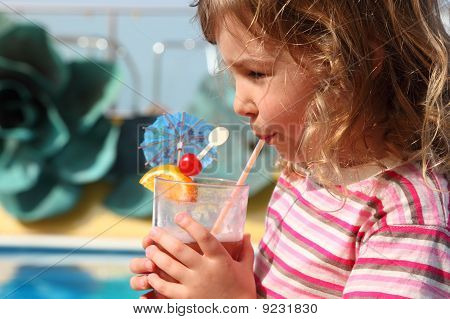 Little Girl In Shirt With Pink Stripes Drinking Cocktail With Fruits, Side View