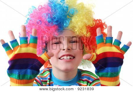 Little Boy In Clown Wig And Multicolored Gloves Smiling
