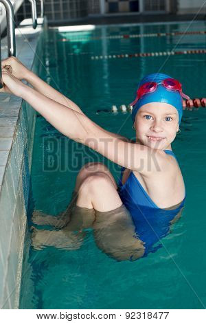 Holding Of Competitions In Swimming. Girl Preparing To Start.