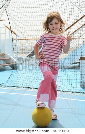 Girl With Yellow Ball Standing Near Football Goal On Cruise Liner Deck
