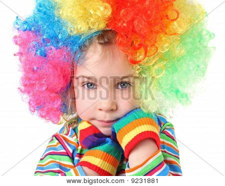 Little Girl In Clown Wig And Multicolored Gloves Looking At Camera, Chin On Hands, Half Body