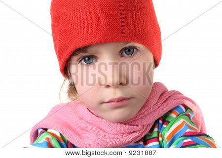 Portrait Of Little Serious Girl In Warm Hat And Scarf, Half Body, Isolated On White