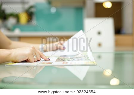 Woman Is Reading Magazine  In The Kitchen