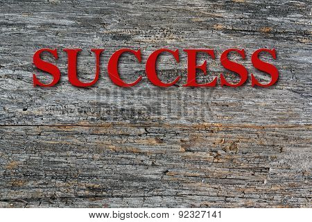 Success text on barn wood side