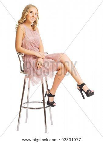 Young woman on metallic chair isolated