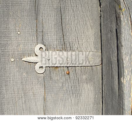 Grey Door Hinge On Wooden Door