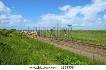 Electric train driving through nature in spring