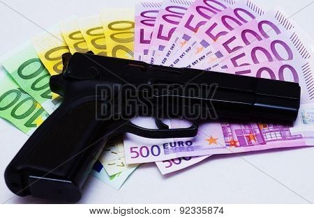 Pistol And Banknotes