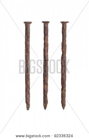 Three Old Rusty Nails on White Background