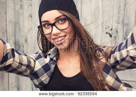 Hipster girl in glasses and braces