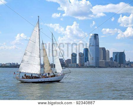 City And A Sail Boat