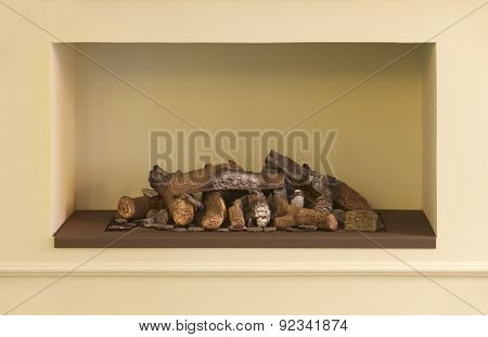 Fireplace With Firewood Ready To Be Lighted In Yellow Tone