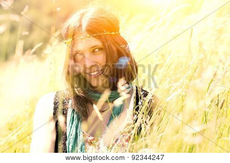 Hippie Girl In The Meadow In A Photograph With Vintage Artifacts Deliberately To Simulate Vintage Ca