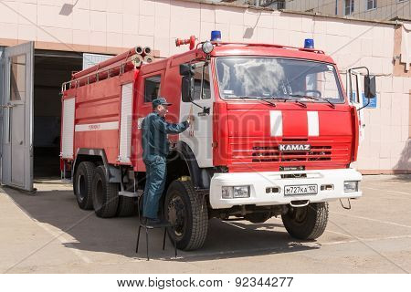 Russian Firemen Working On A Kamaz Fire Vehicle