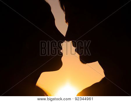 Profiles Of Couple, Looking At Each Other On Background Of Sunset