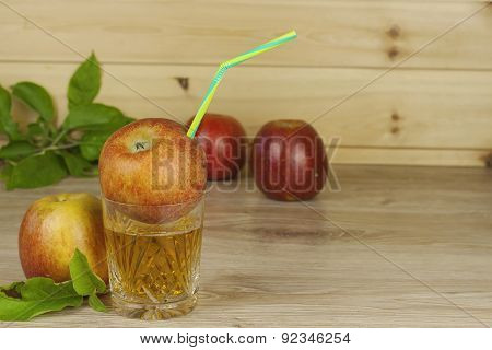 refreshing apple juice standing on a wooden table