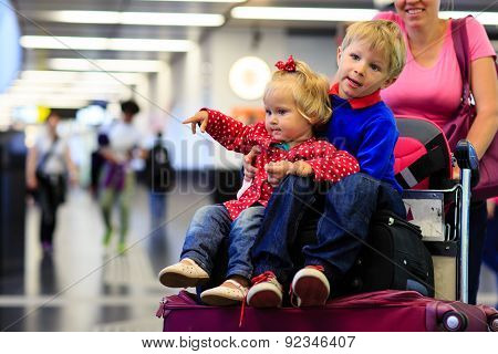 little boy and toddler girl travel in the airport