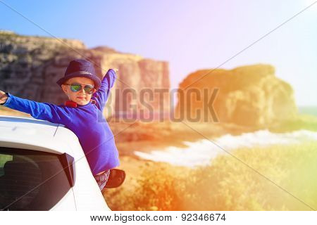 happy little boy travel by car on summer vacation