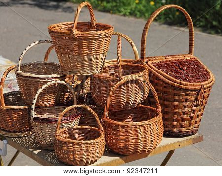 A Lot Straw Basket On Table.