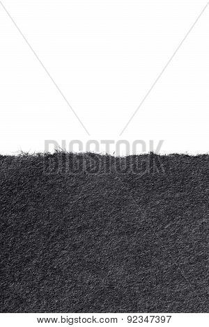 Torn Black Paper Or Paperboard On A White Background
