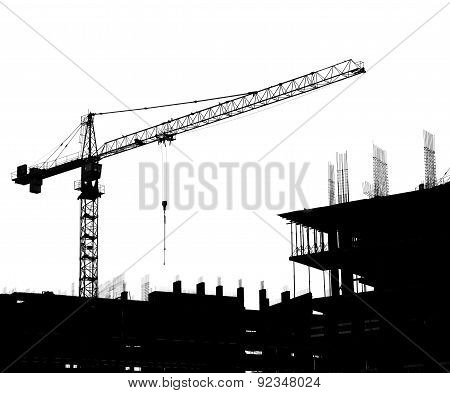 Silhouettes Of A Construction Crane And Building On A White Background