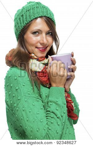 Pretty Woman In Winter Fashion Drinking Coffee