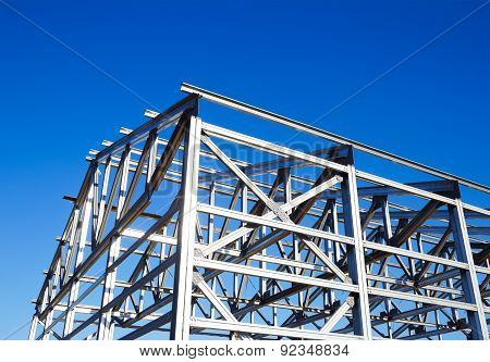 Metal Frame Of The Roof Against The Blue Sky
