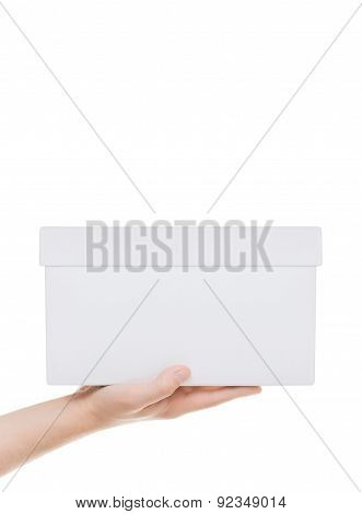 Hand Holding White Cardboard Box. Isolated On White Background With A Field For Text