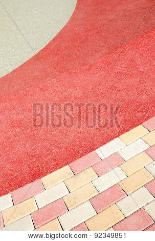 Paved Walkway And Colored Gravel