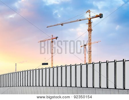 Construction Site. Industrial Landscape With Cranes And Pipe.