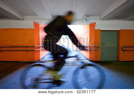 Cyclist Rides Through The Underpass