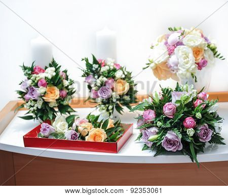 Beautiful bouquets of rose flowers, on table. Wedding bouquets of different colors roses