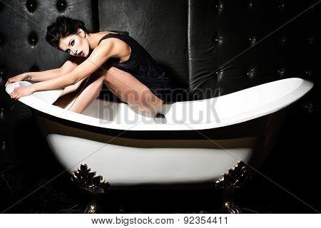 Woman Sitting On Bathtub