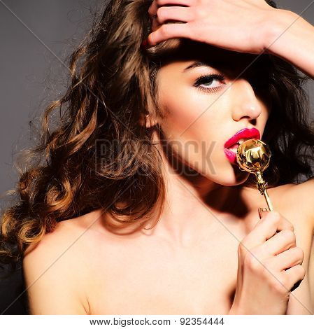 Delicious Woman With Gold Round Lollipop