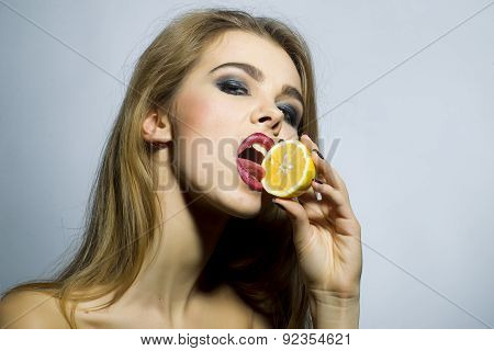 Seducing Blonde Woman Portrait With Orange