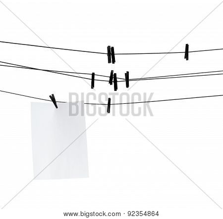 Blank Paper Sheet On Clothesline With Clothespins