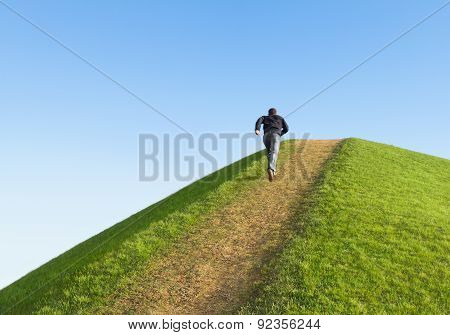 Pathway Up The Hill Against The Sky. Man Ran To The Top. Symbol Development Or Career Growth.