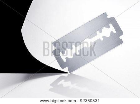 Razor Blade Cuts The Paper