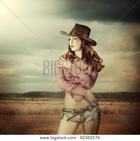 Woman In Cowboy Hat And Sexy Shorts