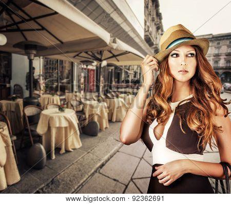 Fashion Portrait Of Woman Wearing Vogue Hat