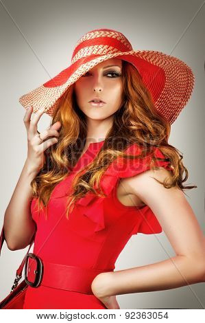 Woman Wearing Vogue Red Hat And Dress