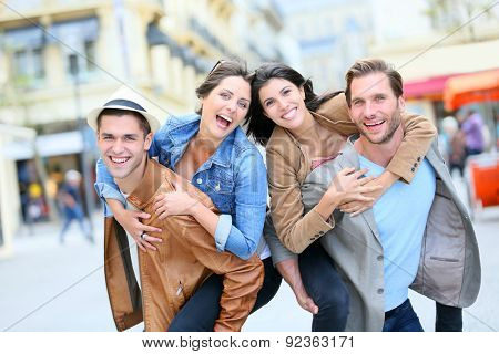 Group of friends getting silly in shopping street